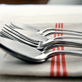 Tablespoons and forks on tea towel (detail)