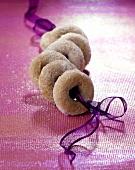 Roscos (doughnuts from Spain) on purple ribbon