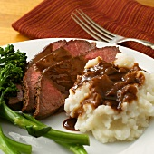 Sliced Roast Beef with Mashed Potatoes and Gravy; Broccolini