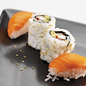 Sushi with salmon and inside-out rolls