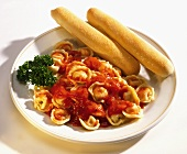 Tortellini with Tomato Sauce and Bread Sticks