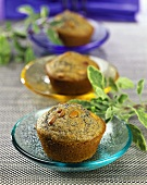 Corn muffins with pine nuts on coloured plates
