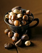 Hazelnuts, almonds and Brazil nuts in a pewter cup