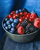 Mixed berries in a metal dish