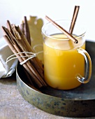 Pineapple and ginger punch with cinnamon sticks