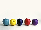 Five painted apples in a row