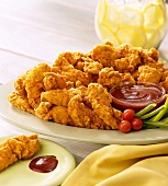 Chicken Tenders (breaded pieces of chicken breast) with dip