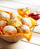 Potato rolls in bread basket, jam beside it