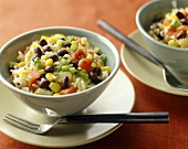 Rice salad with black beans, sweetcorn and tomatoes