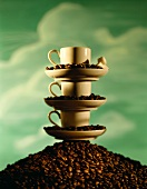 Pile of coffee cups on a heap of coffee beans