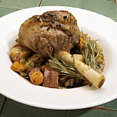 A Braised Lamb Shank with Vegetables and Rosemary