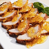 Sliced Roast Pork Loin with Orange Glaze on a Platter