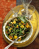 Green beans and yellow peppers with sage, three glasses