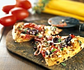 Pizza Slices with Tomatoes, Olives, Basil and Onions