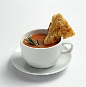 A Cup of Tomato Soup with a Grilled Cheese Triangle