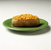 A Baked Sweet Potato on a Green Plate