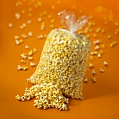 Popcorn in and beside plastic bag