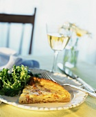 A Slice of Quiche Lorraine with Salad and Wine