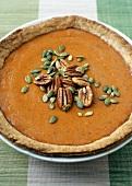 A Pumpkin Pie with Pecans and Pumpkin Seeds