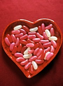 Pink, Red and White Jelly Beans in a Heart Shaped Dish