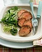 Cold pork fillet, sliced, with salad garnish