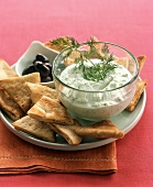 Tzatziki with pita triangles and olives