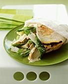 Caesar salad with chicken in pita bread