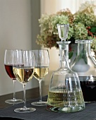 Carafes and glasses of red and white wine