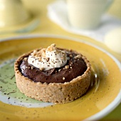 Chocolate Cream Pie Tartlet in an Oatmeal Crust with Whipped Cream