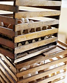 Wooden Egg Crates with White and Brown Eggs