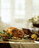 Roast turkey with dried fruit and sage on platter