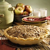 Apple pie in baking dish on cake rack