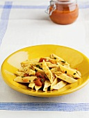 Pasta with Black Pepper and Tomatoes in a Yellow Bowl