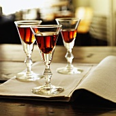 Three Glasses of Port on an Open Book