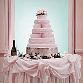 A Multi-tiered Wedding Cake on a Table with Champagne