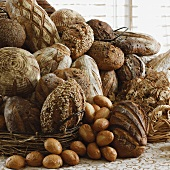 Various Breads in and Next to Baskets