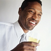 An African-American Man Holding a Glass of White Wine