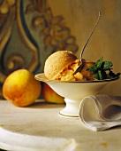 Peach Ice Cream in a Pedestal Bowl with Fresh Mint