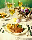 Easter Table Setting with Roast Beef, Potatoes and Asparagus with White Wine