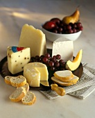 Assorted Cheeses with Fruit and Crackers on a Tray