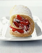 A Rolled Spongecake Filled with Strawberries and Cream