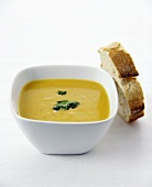 Apple and Parsnip Soup in a Square Bowl with Bread Slice