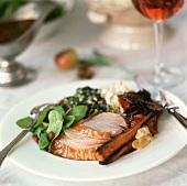 Roast turkey with salad and vegetables on festive table
