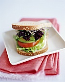 Avocado, lettuce and sprouts in a sandwich