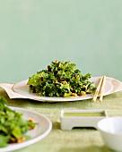 Mixed Green Salad with Walnuts and Wasabi Dressing; Chopsticks