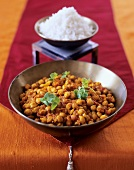 Chick-pea curry with coriander leaves; rice (India)