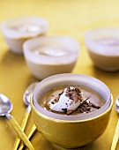 Chocolate mousse with cream and chocolate curls