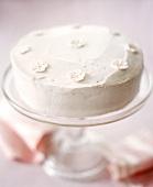 White celebration cake with sugar flowers
