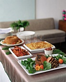Buffet with roast beef and accompaniments in living room