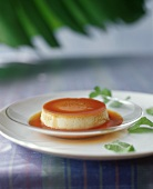Caramel pudding, garnished with mint